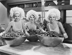 Three ladies taking charge of Food Portions