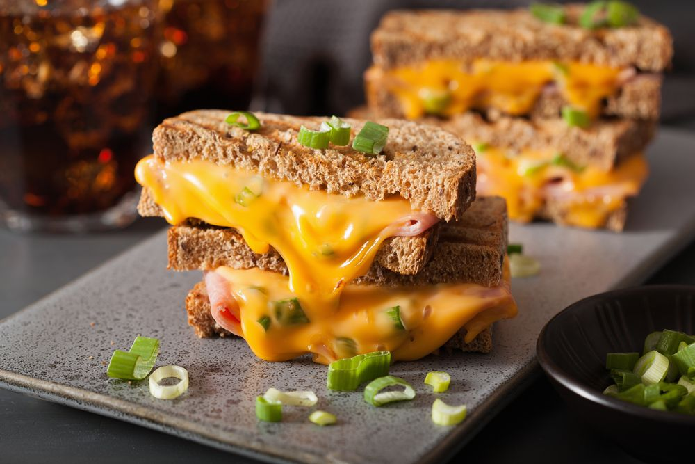 A Grilled Cheese Sandwich with Cold Cut Inside