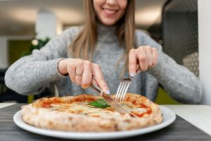 Eating a lot at one meal to lose weight